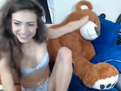 Busty brunette toys with ass on cam