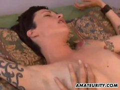 Tattooed brunette with large natural breasts experiencing a