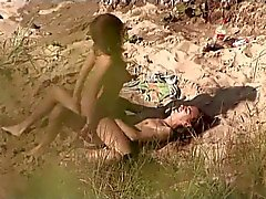 Voyeur on public beach. Hot young couple sex