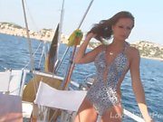Brunette bombshell shows off on the boat