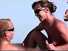MILF Giving A Blowjob At The Beach