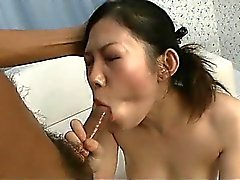 Pretty babe Yui Komine uses a sex toy to play with her