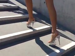 Long legs, mini dress, outside, up the stairs.