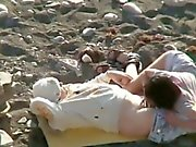 Horny amateurs on the beach secretly filmed