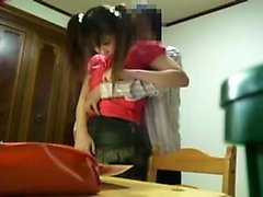 Pigtailed Oriental cutie kneels down and confesses her love