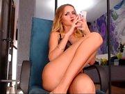 Beautiful blonde in solo striptease porn