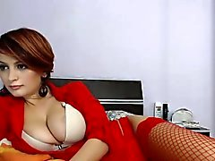 Sensuous beauty in sexy red lingerie shows off her perfect