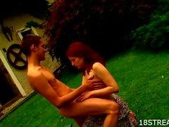 Teen enjoys sex on the grass