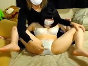 Hot asian kitten fingering herself on live webcam