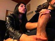 Big brunette gives handjob to hard cock