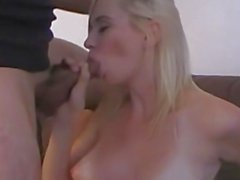 Petite blonde stuffs her mouth with cock