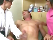Doctor and nurse squeeze a guys dick hard