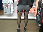 Provoking babe in stockings flashes her tight slit in a pub