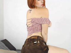 Irresistible redhead camgirl in high heels is yearning for