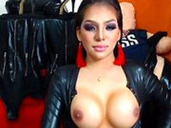 Latex Lucy shows off her great round boobs