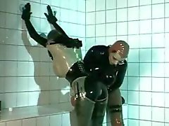 Rubber clad lesbian babes are playing with pussy in hot fetish video
