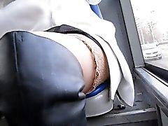 Chick in stockings and black leather boots in a bus