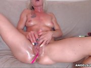 Sensual Shaved Chick Plays With Her Twat