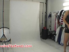 Stunning woman yourself in backstage hold in dress