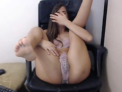 Horny brunette milf toys and rubs pussy at work