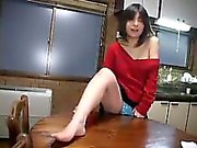 Sexy slender housewife uses the kitchen table to please her