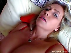 Chubby mature blonde with big tits vibs up her clit