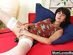 Brunette cougar strips and plays pussy in solo