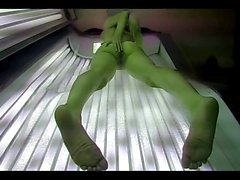 skinny blond in public solarium playing.mp4