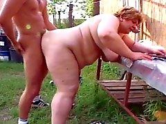 Fat granny sucking young cock in farm