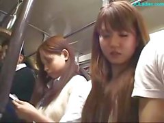 Japanese lady gets her nipples sucked and her pussy fingered on the bus
