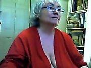 Large Grandma Strips And Masturbates