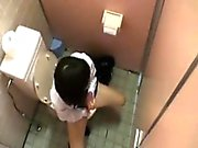 Two lovely Asian schoolgirls exchange passionate kisses in