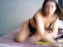 Teen brunette in black lingerie toying pussy on webcam