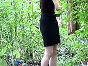 Gal walks into the woods to change her clothes into evening