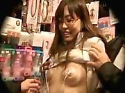 Naughty Asian chick raises her shirt and gets her tits play