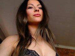 Sexy brunette in black stockings and lingerie sucks dick