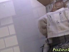 Kinky asian pee in toilet