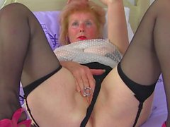 Busty granny with big piercing in old clit