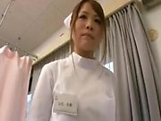 Stunning Oriental nurse exposes her perky boobs and seduces