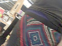 Hidden camera upskirt video of a woman walking in the books