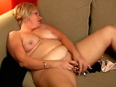 Chubby mature blonde toys her wet pussy