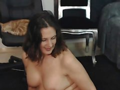 hot brunette MILF playing with her toys on cam