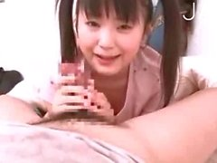 Pigtailed teen girl gives head