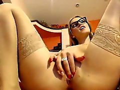 Nerdy blonde in stockings uses her fingers to satisfy her s