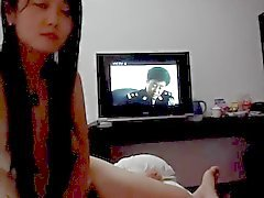 Beautiful Chinese girl gives a blowjob