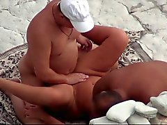 At a public beach man share his wife with a stranger voyeur