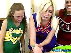 Blonde teen cheerleader jerks and tugs cock