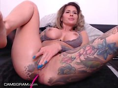 Adorable Tattooed Busty Camgirl Squirting Everywhere