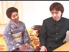 Asian MILF Chizuru Iwasaki gets a young boy to eat cock and fuck