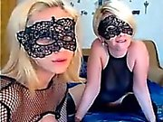 Two sexy blondes with mask fuck and suck